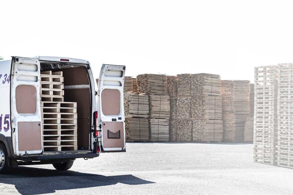 Truck carrying wooden pallets